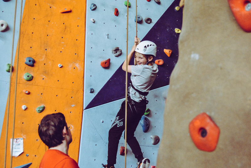 kid climbing indoor rock wall