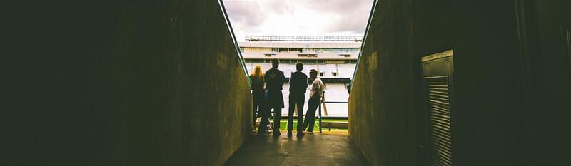 football players entering stadium