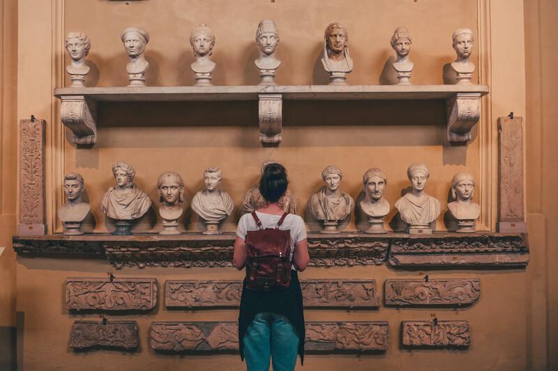 woman looking at art exhibit