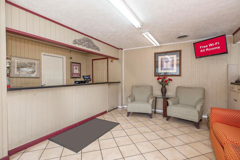 Red Roof Inn Starkville - University Front Desk and Lobby Sitting Area Image