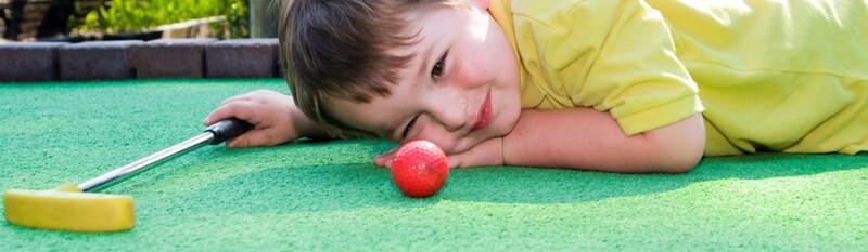 child on miniature golf course