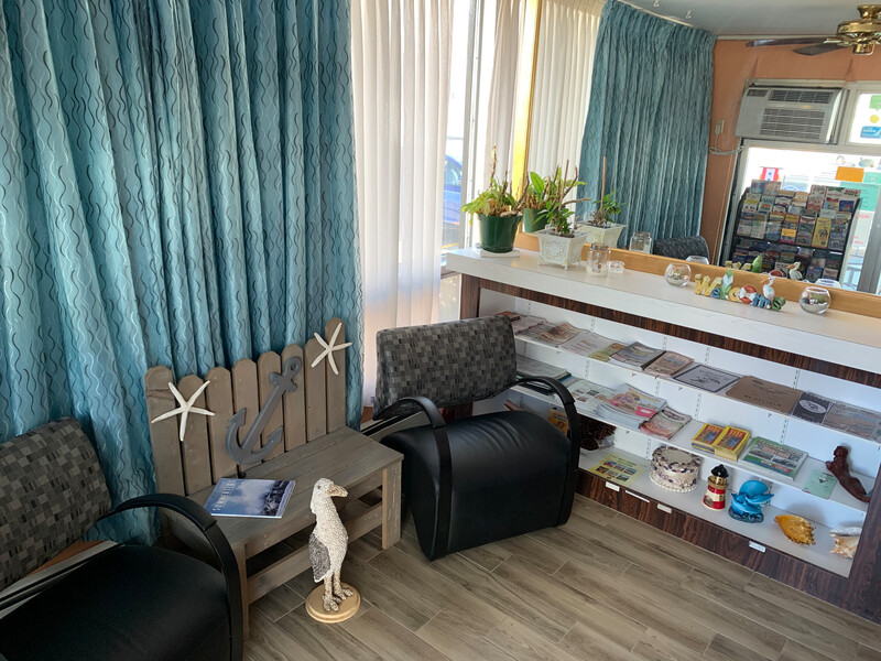 Le Voyageur – a Red Collection Hotel Front Desk and Sitting Area