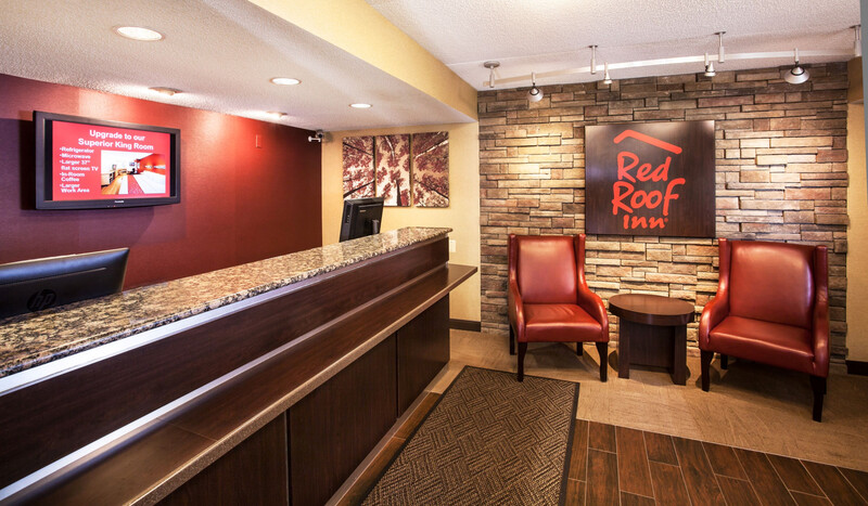 Red Roof Inn Utica Front Desk and Lobby Sitting Area Image