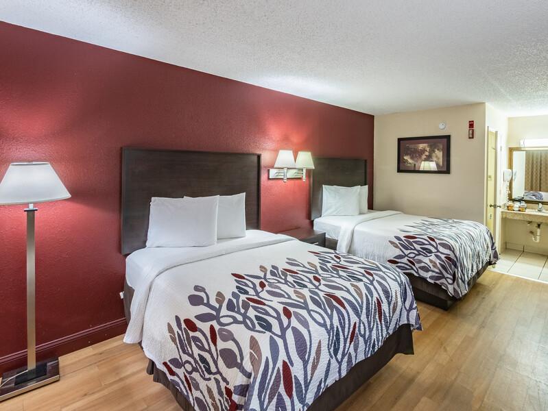hotel room with wood floors