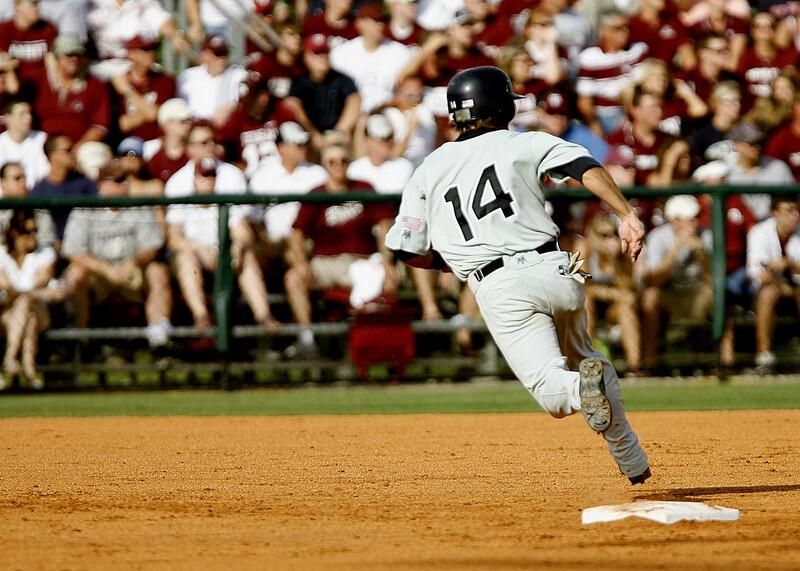 Baseball player running bases